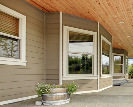 Residential home with new energy efficient windows and vinyl siding
