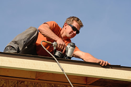 Roofing contractor working on simple roofing repairs